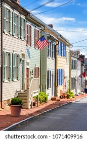 Traditional Colourful Wooden Town Houses along an Old Brick Sidewalk in Annapolis, MD, on a Sunny Fall Day
