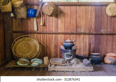 Traditional common thai kitchen with old kitchenware.