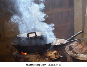 Traditional cooking within dim light and smoke.