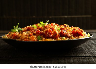 Traditional cooking- wok stir fry rice and chicken with spices.