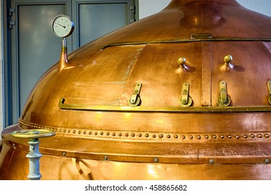 Traditional copper distillery tanks in a beer brewery