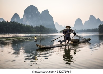 traditional cormorant fisherman on Li river near Xingping, Guangxi province, China.