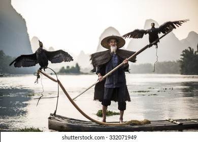 traditional cormorant fisherman showing of his birds on Li river near Xingping, Guangxi province, China.