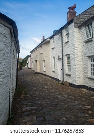 Traditional Cornish cottages lining a cobbled street in Boscastle in Cornwall