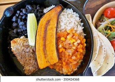 Traditional Costa Rican Casado meal with rice, beans and plantains