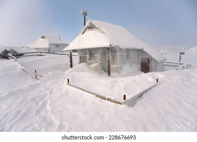 Traditional cottages on Velika planina in winter, Slovenia