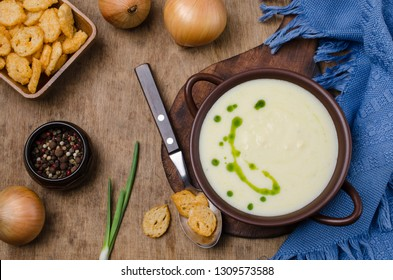 Traditional cream vegetable soup with croutons in a bowl on the table. Selective focus.