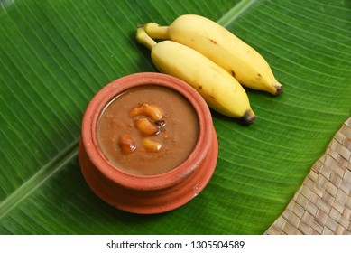 Traditional creamy Parippu Payasam or Dal Kheer dessert Kerala, South India. Indian mithai served on birthdays. Delicious festival feast sweet dish for Onam, Vishu, Deepawali on banana leaf background