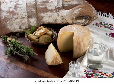 Traditional Cretan delicacies cheese, rusks and raki.