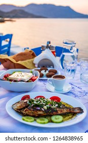 Traditional Cretan Dorada fish with Greek salad, Kissamos, Crete, Greek Islands, Greece, Europe