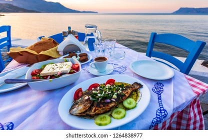 Traditional Cretan Dorada fish with Greek salad, Kissamos, Crete, Greek Islands, Greece, Europe