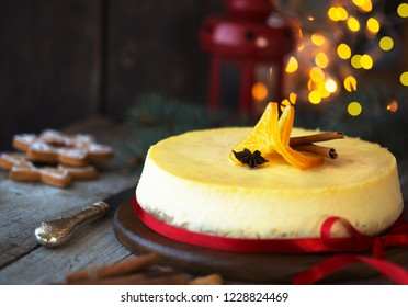 Traditional Cristmas cheesecake with orange,  decorations