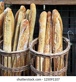 Traditional crusty French baguette bread in baskets