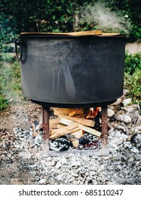 Traditional cuisine big black pot cooking food, natural fire with wood heating