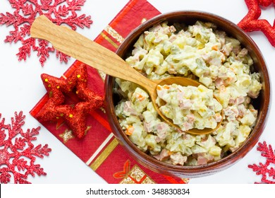 traditional cuisine russian salad on white christmas background close up