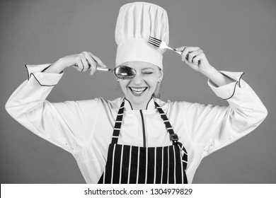 Traditional culinary. Professional cook of culinary school. Culinary arts academy. Culinary school concept. Woman professional chef hold utensil spoon fork having fun. Time to eat. Appetite and taste.
