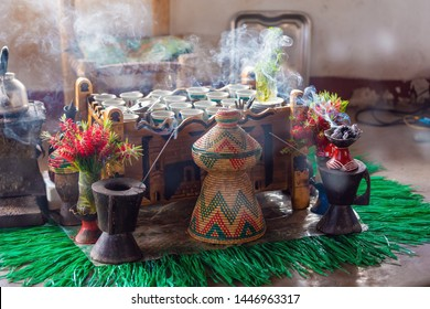 Traditional cup of Ethiopian coffee served with aromatic essence. Ceremony with Incense, usually frankincense and myrrh ignited by a hot coal to produce smoke that carries away any bad spirits. Ethiop