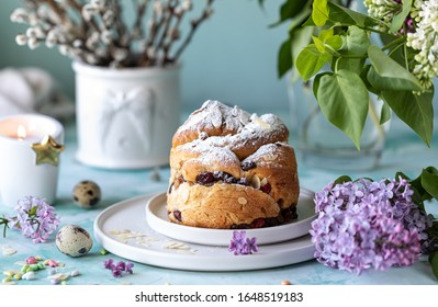 Traditional cupcake Easter cake kraffin with raisins and icing sugar on the table. - Shutterstock ID 1648519183