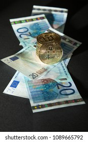 Traditional currency (euro) versus digital currency (bitcoin); black background