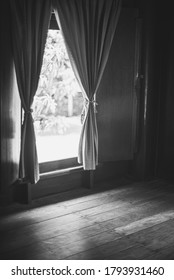 The traditional curtains with window of traditional wooden room in black and  white colour.