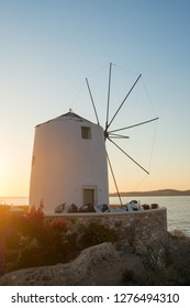 Traditional cycladic windmill at sunset on Paros island, Cyclades, Greece