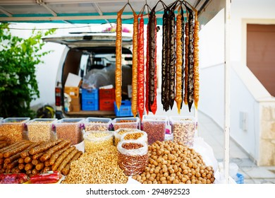 Traditional Cypriot Sudzukos, or Georgian sausage-shaped candies, the churchkhela, also called the Georgian snickers at the market.