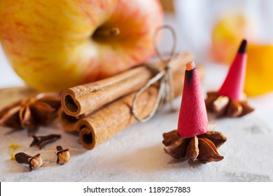 traditional Czech christmas and advent time - smoking incense cones and star anise and cinnamon spice - festive decoration