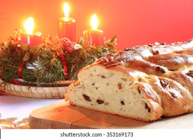 Traditional Czech Christmas cake in a glass bowl with candles in the background