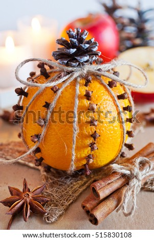 traditional Czech christmas - decoration - orange decorated with cloves, cinnamon and apple. Homemade decoration.