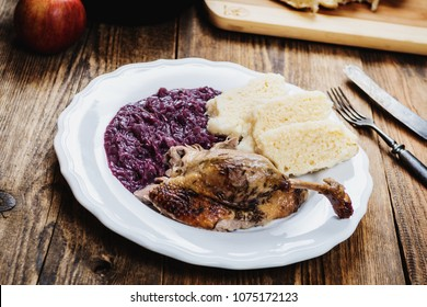 Traditional czech cuisine  baked duck with red cabbage and dumplings