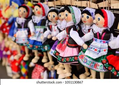 Traditional Czech dolls. Tourist souvenirs in the center of Prague.
