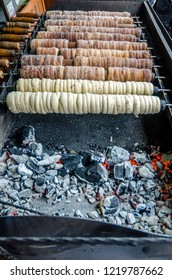 "Traditional Czech sweet treat ""Trdelnik"". To prepare on a special wooden skewers over hot coals. A popular dish among tourists."