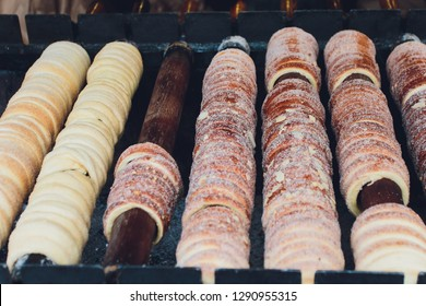 Traditional Czech sweet treat Trdelnik. To prepare on a special wooden skewers over hot coals. A popular dish among tourists.