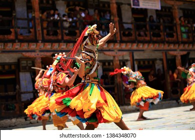 Traditional dance and colors in Mongar, Bhutan,A monk in a colorful dress with mask during the tsechu (dance festival),fastival bhutan