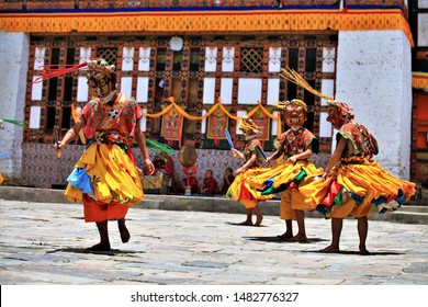 Traditional dance and colors in Mongar, Bhutan,A monk in a colorful dress with mask during the tsechu (dance festival),festival in bhutan