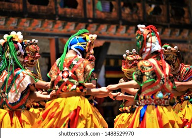 Traditional dance and colors in Mongar, Bhutan,A monk in a colorful dress with mask during the tsechu (dance festival),mask fastival