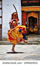 Traditional dance and colors in Mongar, Bhutan,A monk in a colorful dress with mask during the tsechu (dance festival),mask festival