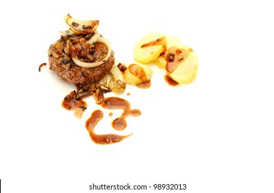 Traditional Danish beef burger, also known as hakkeboef,  with  onion and potatoes and gravy isolated on white