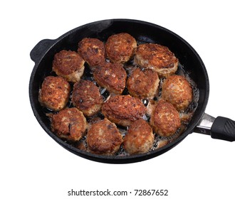 Traditional Danish frikadelles, type of meatball, cooking on a pan