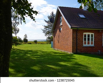 Traditional Dansih bricks house homeby the sea ocean Funen Denmark