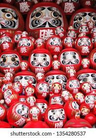"Traditional daruma dolls with a Chinese character meaning ""VICTORY"" at Katsuo-ji temple, Osaka, Japan"