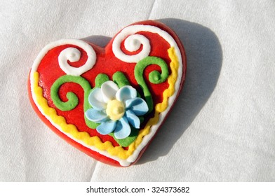 Traditional decorated lect heart, similar to gingerbread. Dessert is meant not for food but for a present. Red color and shape of heart are symbols of love and passion.