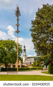 Traditional decorated maypole in alpine village St.Gilgen, Austria.Maypole is erected during folk festival on May 1