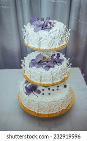 A traditional and decorative wedding cake at wedding reception.