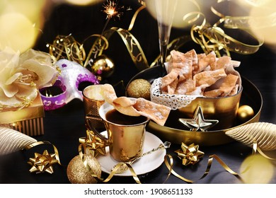 traditional deep fried pastry faworki on black and golden color background for carniwal party in Poland