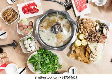 Traditional delicious Chinese steamboat or hotpot with delicious food spread of vegetable and meat