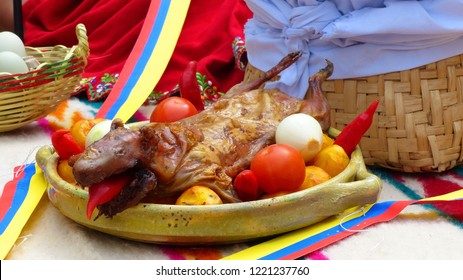 Traditional delicious food of South America - Roasted Guinea Pig or Cuy decorated with strips of colores of national flag,  at food market in Cuenca, Azuay province, Ecuador