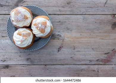 Traditional delicious Swedish semlor on a rustic table, semla.