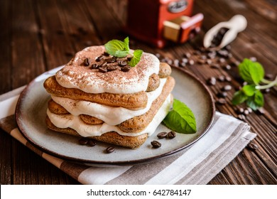 Traditional delicious Tiramisu cake served on a plate