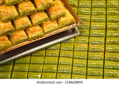 Traditional, delicious Turkish baklava and green pistachio nut sarma .